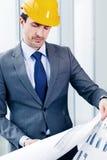 Businessman in construction helmet Royalty Free Stock Photo