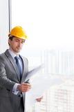 Businessman in construction helmet Royalty Free Stock Photos
