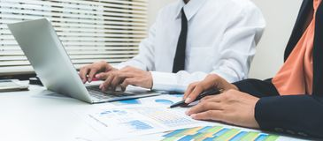 Businessman consult having team meeting discussing new plan financial graph data stock photo