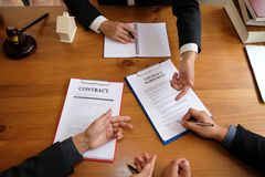 Businessman consult lawyer & sign contract agreement. team meeting at law firm. estate law & property auction concept. Businessman consulting lawyer & signing royalty free stock photos