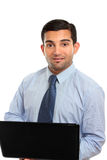 Businessman or IT consultant. A businessman, office worker or IT consultant using a laptop computer.  White background Royalty Free Stock Photo