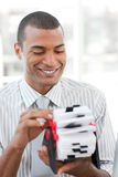 Businessman consulting a business card holder Royalty Free Stock Photos