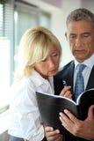 Businessman consulting his agenda Stock Image