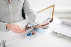Businessman consulting his agenda Stock Photo