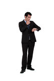 Businessman consulting his watch Royalty Free Stock Photography