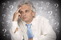 Businessman. Contemplating over ideas and question mark Stock Images