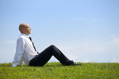 Businessman contemplating in park Royalty Free Stock Images