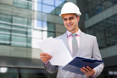 Businessman contentedly reading documents stock image