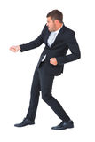 Businessman contorted with hands out. On white background stock photography