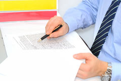 Businessman with contract Stock Photos