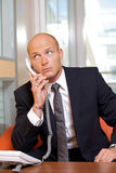 Businessman conversing on landline phone Royalty Free Stock Images