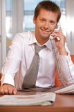 Businessman conversing on landline phone, portrait Royalty Free Stock Images