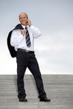 Businessman conversing on mobile phone Royalty Free Stock Photos