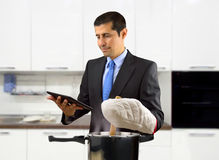 Businessman cooking Stock Image