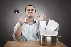Businessman cooking a paperwork stew Stock Photography