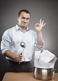 Businessman cooking a paperwork stew Stock Photos
