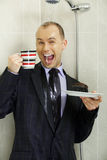 Businessman cooling down under a shower Stock Photos