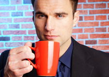 Businessman with cop of coffee Royalty Free Stock Images