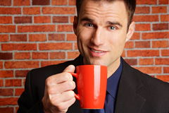 Businessman with cop of coffee Royalty Free Stock Photo