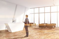 White office reception area corner, man royalty free stock photography