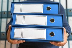 Businessman with corporate files in document binder, blank label Royalty Free Stock Photos