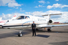 Businessman at Corporate Jet Stock Image