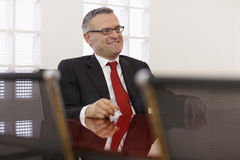 Businessman in corporate meeting Royalty Free Stock Photo