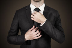 Businessman correcting tie fashion Stock Photo
