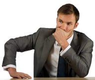 Businessman corrects a suit Stock Images