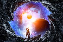 Businessman and cosmos concept. Back view of businessman on fantasy space background. Elements of this image are furnished by NASA Stock Photos