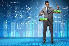 The businessman in cost benefit balance concept. Businessman in cost benefit balance concept royalty free stock photo
