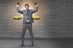 The businessman in cost benefit balance concept. Businessman in cost benefit balance concept stock images
