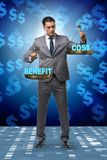 The businessman in cost benefit balance concept. Businessman in cost benefit balance concept royalty free stock photos