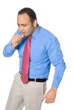 Businessman coughing into his hands Royalty Free Stock Photo