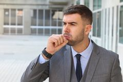 Businessman coughing in office space.  stock photos