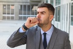 Businessman coughing in office space Stock Images
