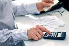 Businessman counting bills. Royalty Free Stock Images