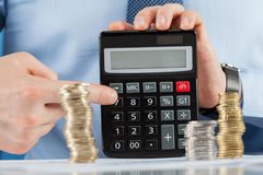 Businessman counting coins Stock Image