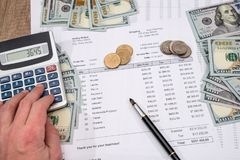 Businessman counting the cost of purchases. Business concept Stock Photography