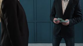 Businessman counting dollar banknotes. A business deal with the transfer of money. Close-up of man gives a stack of stock video