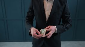 Businessman counting dollar banknotes close up. Businessman counting dollar banknotes close up stock video footage