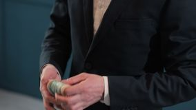 Businessman counting dollar banknotes close up. stock footage