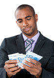 Businessman counting Euros Royalty Free Stock Images
