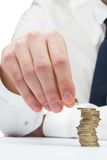 Businessman counting his coins at desk Royalty Free Stock Photo