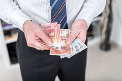 Businessman counting his money Royalty Free Stock Photo