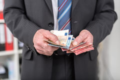 Businessman counting his money Royalty Free Stock Image