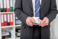 Businessman counting his money Stock Image