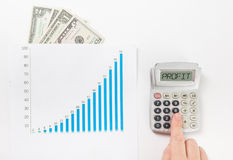 Businessman counting losses and profit working Stock Photo