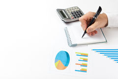 Businessman counting losses and profit working with statistics, analyzing financial the results on white background Royalty Free Stock Image