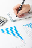 Businessman counting losses and profit working with statistics, analyzing financial the results on white background Stock Photo
